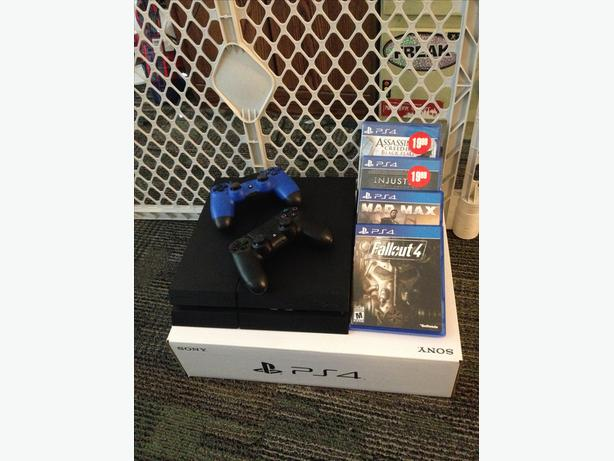 PS4 WITH 2 CONTROLLERS AND 4 GAMES, MINT CONDITION