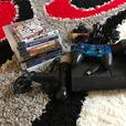 PS3 slim with 2 controllers, 9 games, PS move camera and controller