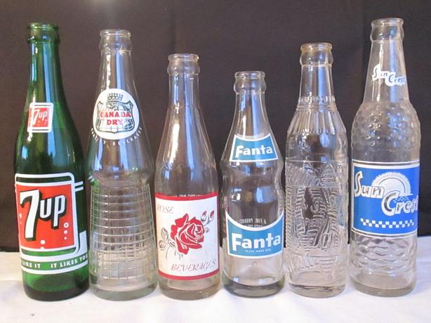 6 Antique glass collectable pop bottles Asking $20.00