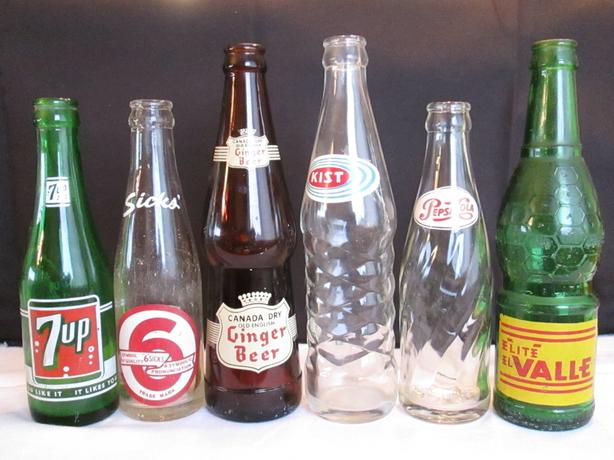 6 Antique glass collectable pop bottles