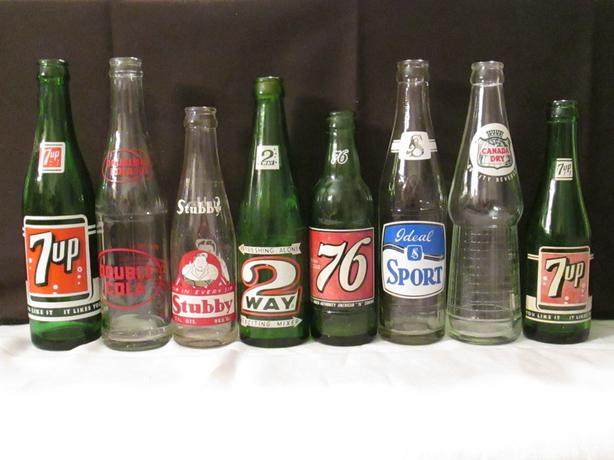 8 Antique glass collectable pop bottles