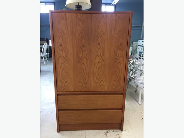 Handsome teak armoire cabinet