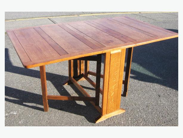 Solid OAK drop side dining room table folds down to narrow hall table