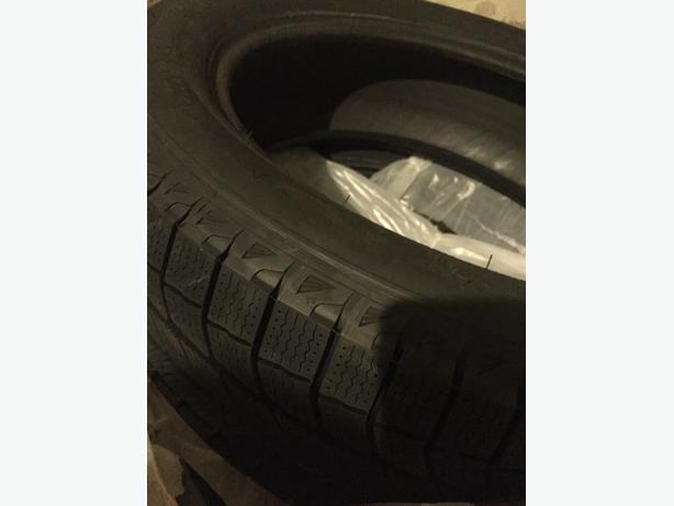 "Brand new Latitude Ice X Winter Tires for 20"" rim"