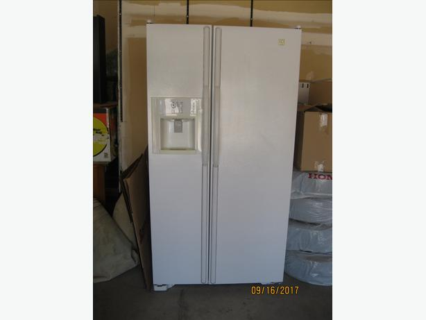 White side by side Maytag refrigerator in good working condition