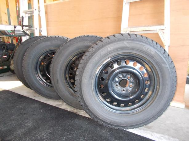 Four Goodyear  R Winter Tires On Steel Rims