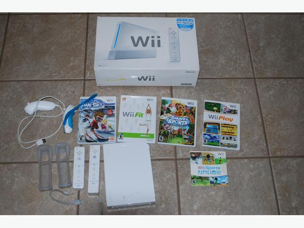Wii System: Console, 2 controllers, 2 numchucks, 5 games