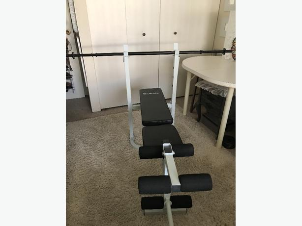 Fold up bench press and leg extension new