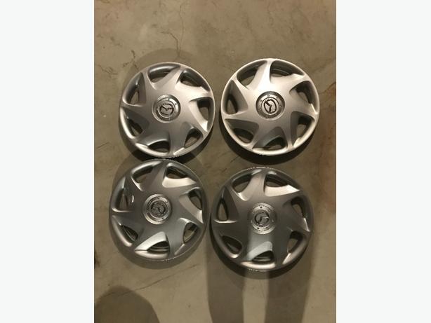 "Mazda set of hubcups 16"" wheel covers (originals)"