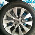 Four R16 Yokohama AVID ENVigor Summer tires on Alloy Rims