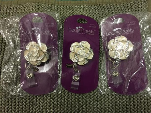 Rose badge reels