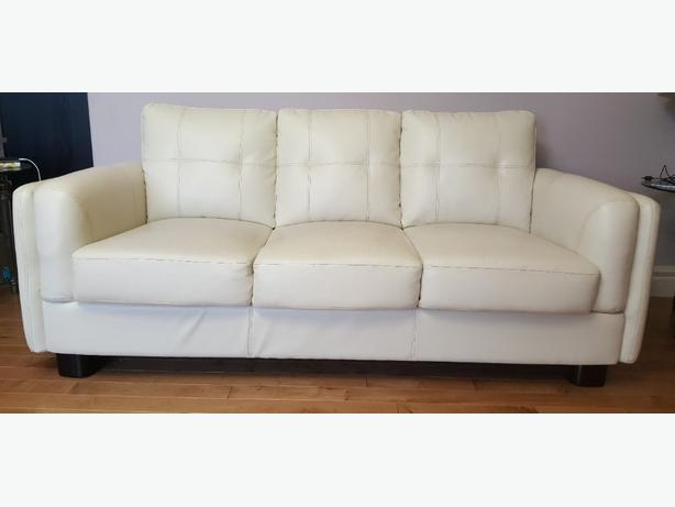 white faux leather sofa