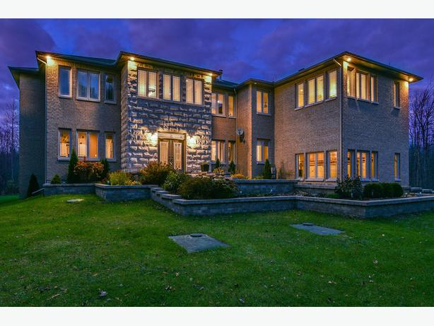 STUNNING home in beautiful Rideau Forest! Luxury family living!