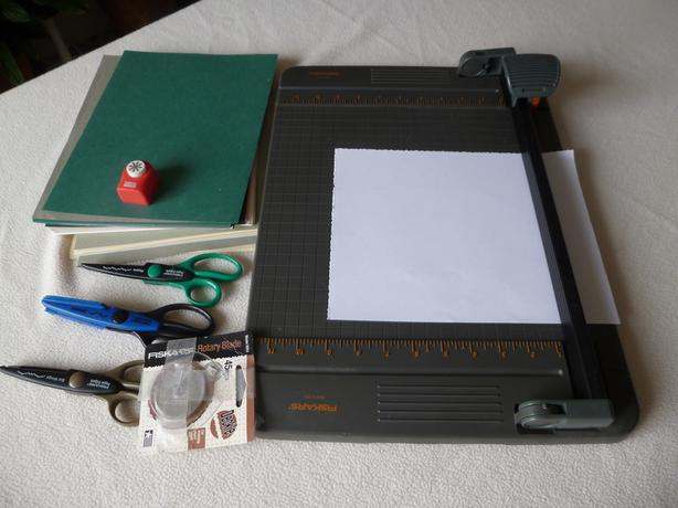 Paper cutter and acid-free paper for scrap-booking