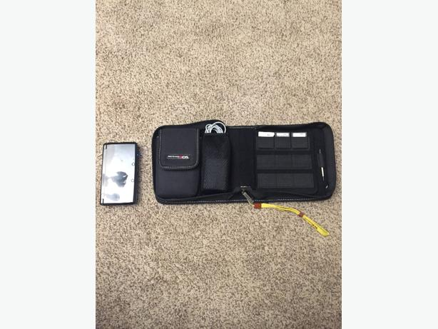 nintendo 3ds with three games and a case