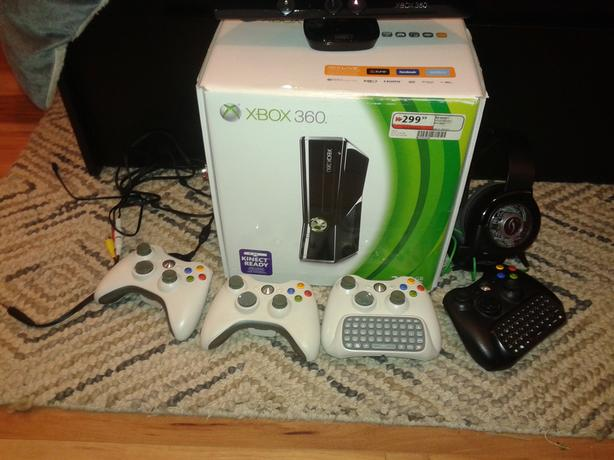 $165/obo Xbox 360 slim, 4 controllers kinect sensor 11 games