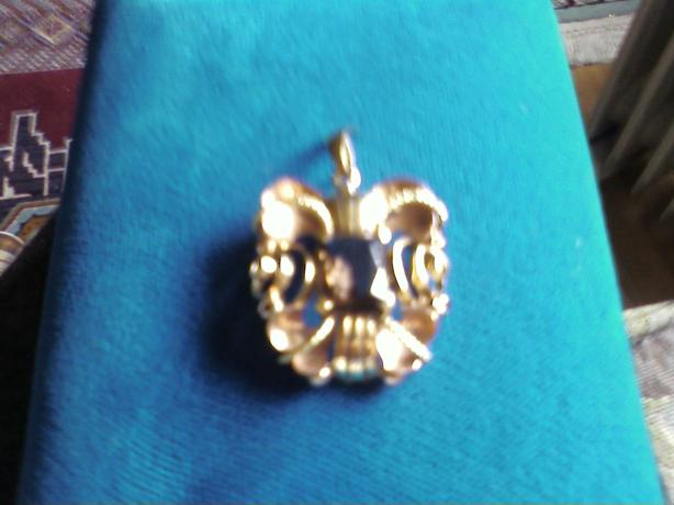 Elegant, 14K Gold pendant.