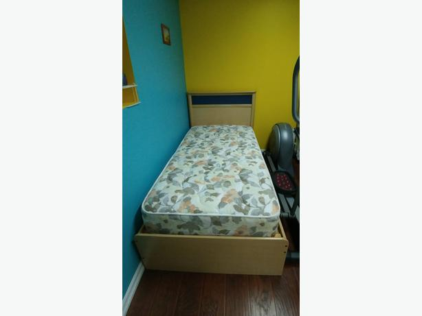Twin mattress with bed and night table