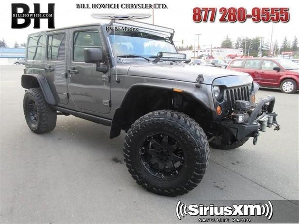 2012 Jeep Wrangler Unlimited Rubicon - Air - Tilt - $245.35 B/W