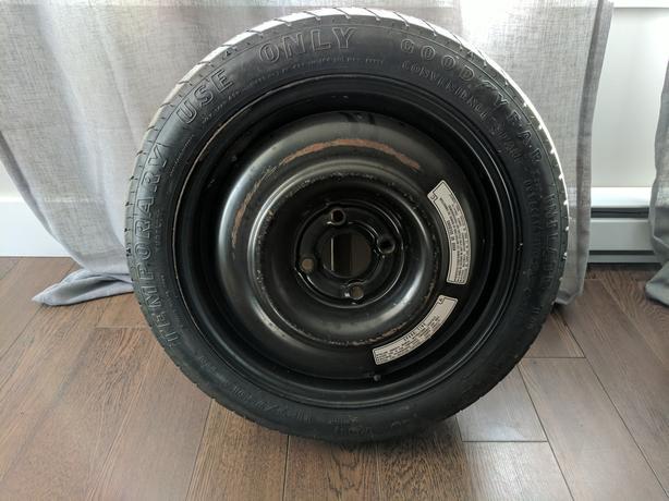 Three rims, four wheel covers and a spare tire for a 2014 Kia Rio