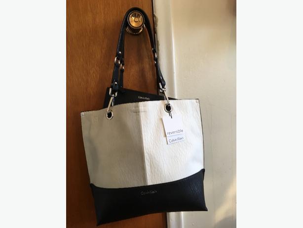 """Calvin Klein purses and 1 Guess purse"