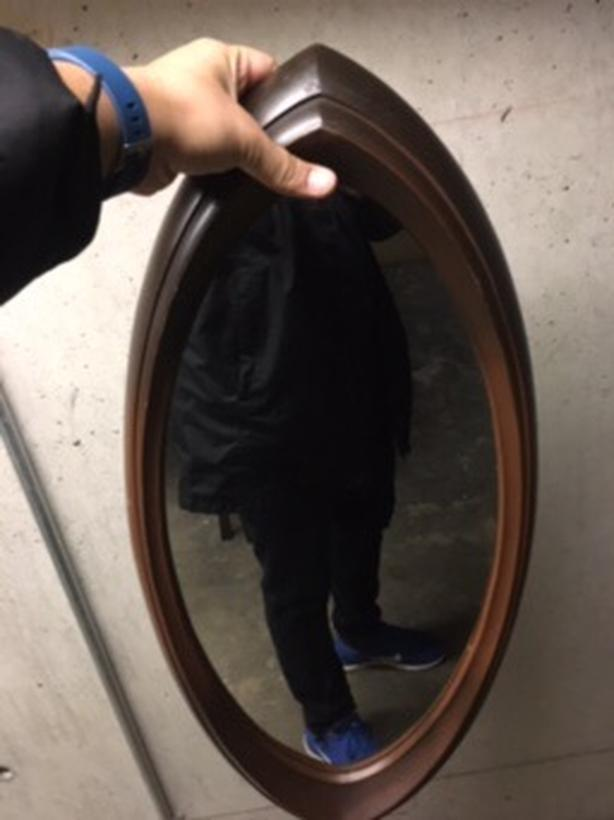 Antique eye shaped mirror