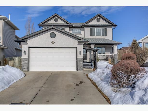 Fabulous developed Chestermere Home Backing Onto greenspace