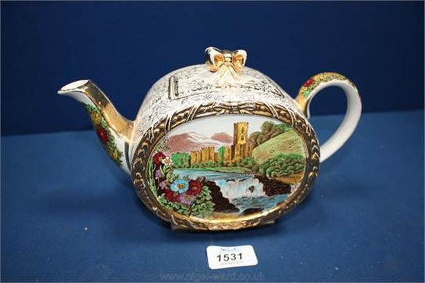 Antique gold plated teapot