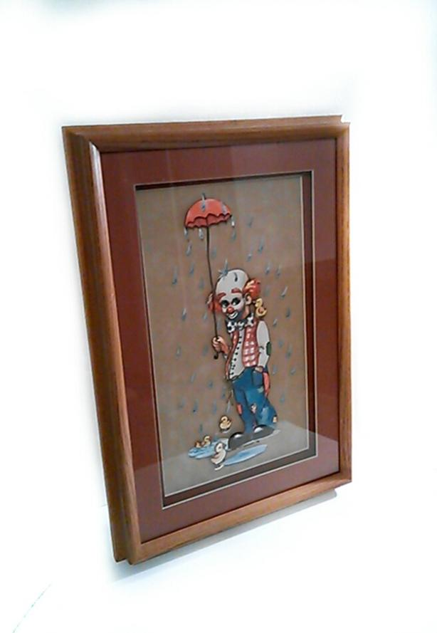 Clown carrying umbrella with ducklings painting