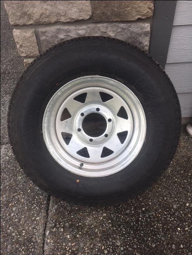 Brand new trailer tire on Galvanized wheel