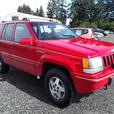 1993 Jeep Grand Cherokee, no reserve sold to highest bidder, four wheel drive.