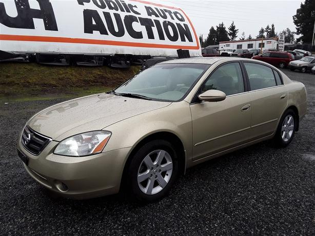 2004 Nissan Altima front wheel drive, 4 cylinder, 219k km's!