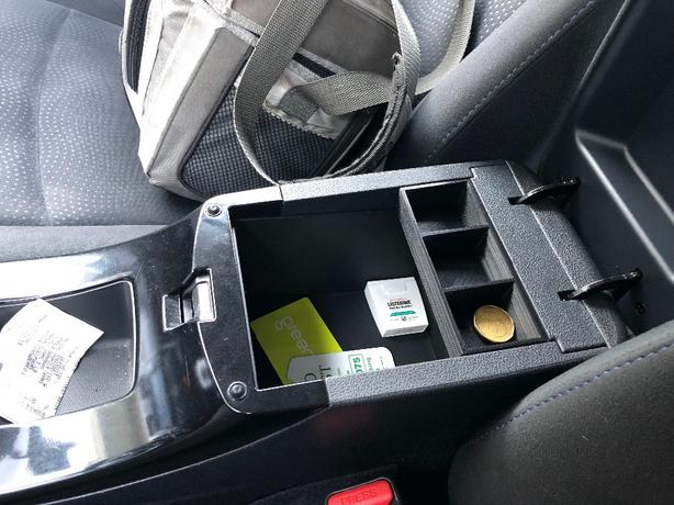 Nissan Leaf coin holder tray.