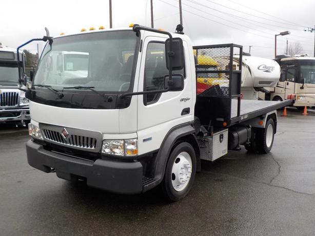 2009 International CF 600 Diesel Tilting Flat Deck