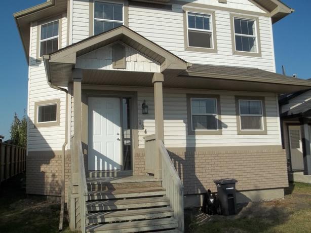 224 Cimarron Blvd, Okotoks AB, Available July 1st Rent to Own!