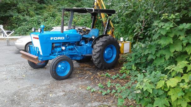 ford tractor and brush cutter
