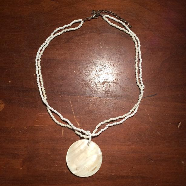 Beautiful Shell Pendant On A Beaded Necklace