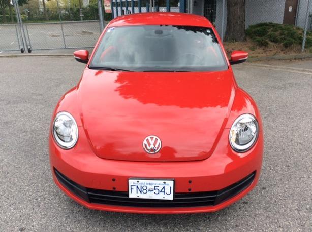 2012 VW Beetles - red