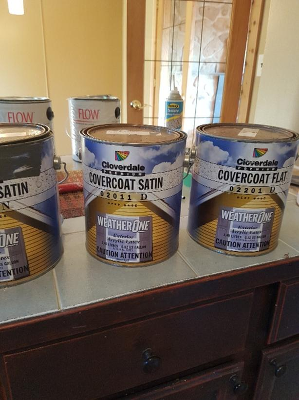 near new cans of Cloverdale premium paint