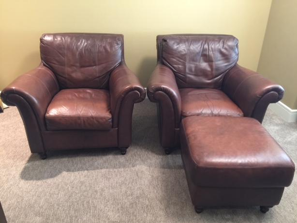 Two Large Leather Chairs and One Matching Ottoman