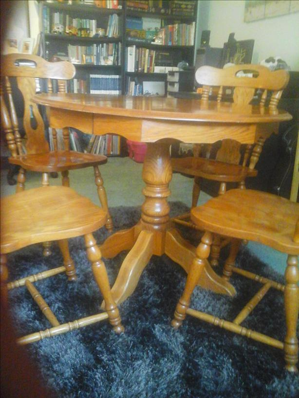 Vintage round pedestal table and chairs