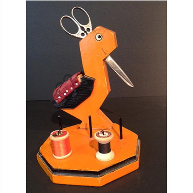 Vintage wooden bird-shaped sewing caddy with German-made scissors