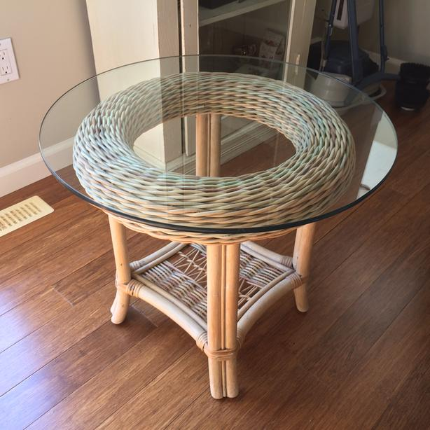 Glass-topped, pastel-coloured, wicker corner table