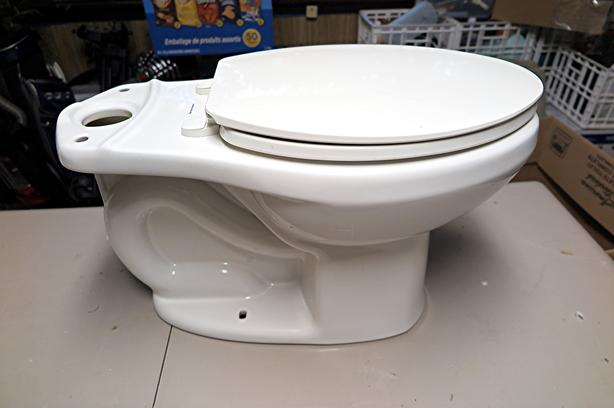 As new American Standard toilet with seat.