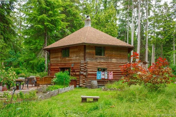 Unique 4 bedroom log home on .96 of an acre Shirley