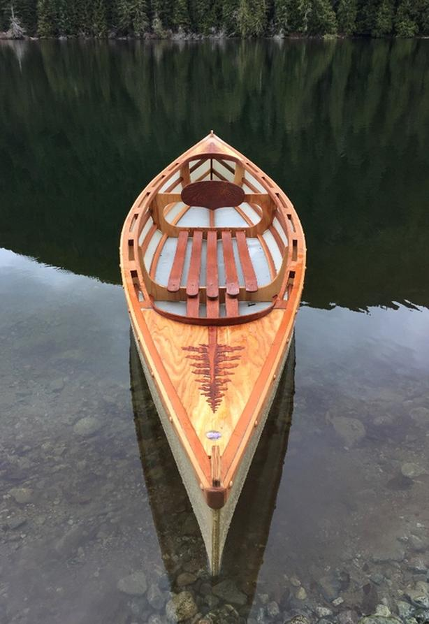 Locally hand crafted skin on frame solo boats. kayak/canoe