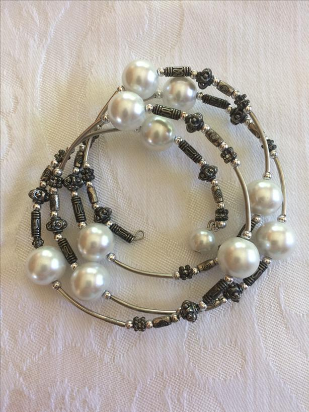 SILVERTONE TWIRLY BRACELET WITH FAUX PEARLS