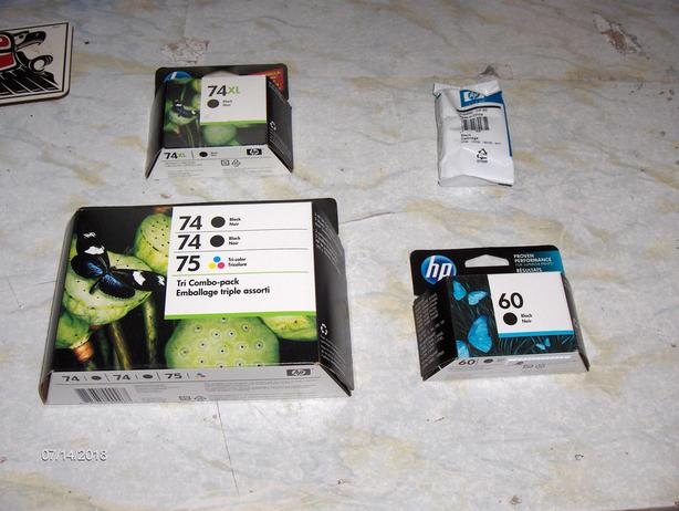 Brand-new, unopened HP black and colour ink cartridges