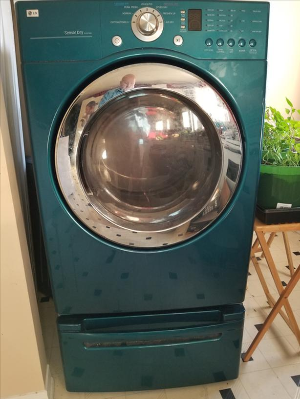Front-load electronic LG Dryer with riser - nearly 9 yrs old