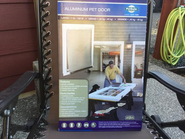Large New Aluminum dog Door with flap.